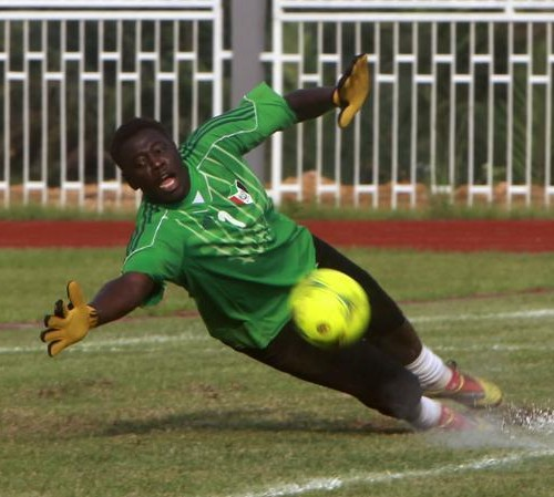 Sudan's goalkeeper Bhaldien Mohammed tries to catch the ball during a training session in Bata